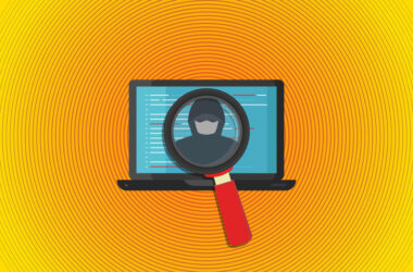 Illustration of a magnifying glass revealing a hacker on a laptop screen.