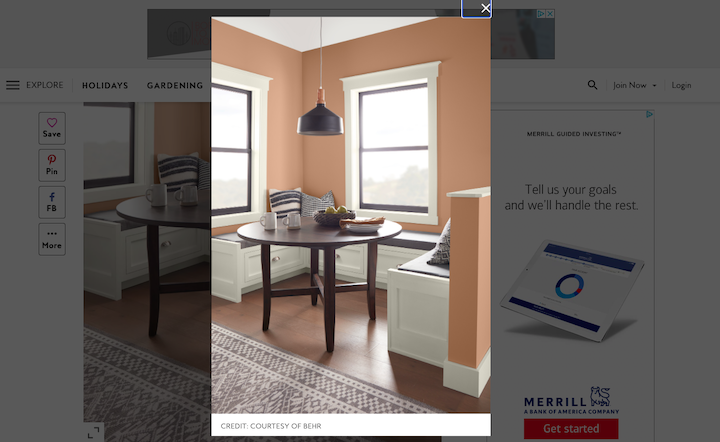 Screenshot from Better Homes and Gardens featuring a subtle earthy orange paint on the walls of a minimal dining room