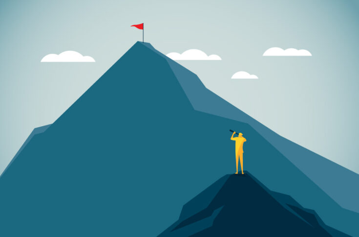 A figure on a low peak looks through a telescope at a flag on a high mountain in the distance
